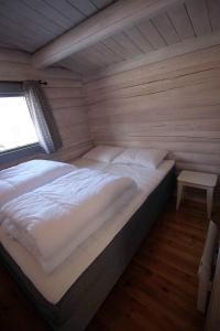 En eller flere senger på et rom på Trollstigen Resort