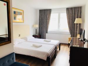 Un pat sau paturi într-o cameră la Hotel EKA