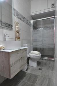 A bathroom at On The Beach