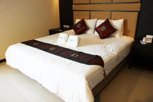 A bed or beds in a room at White Inn Nongkhai