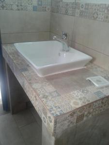 A bathroom at Floras Rooms and Studios