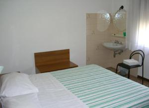 Cama o camas de una habitación en Hotel Vidale