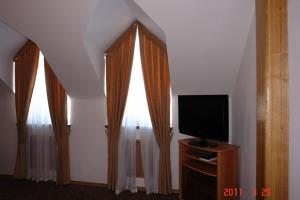 A television and/or entertainment center at Pallada