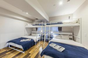 A bunk bed or bunk beds in a room at Minn Juso