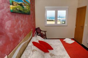 A bed or beds in a room at Muxia Mare