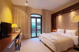 Łóżko lub łóżka w pokoju w obiekcie Pensjonat Kazimierski