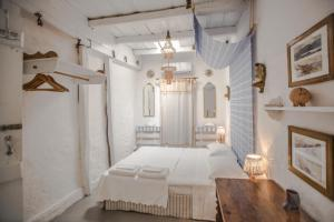 A bed or beds in a room at Holiday in the Real Crete