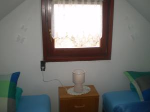 A seating area at Holiday Home Manda