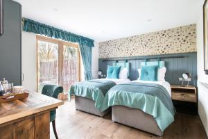 A bed or beds in a room at The Green Dragon Inn