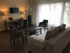 A seating area at Fletcher Hotel-Restaurant de Witte Brug