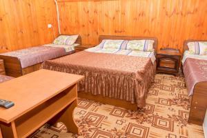 Кровать или кровати в номере Гостевой дом Ника
