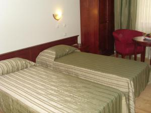 A bed or beds in a room at Rachev Hotel Residence