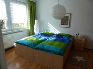A bed or beds in a room at LICHTenstein