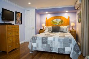 Un ou plusieurs lits dans un hébergement de l'établissement Maison Des Jardins B & B