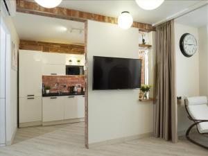 Телевизор и/или развлекательный центр в Cozy39