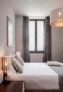 Кровать или кровати в номере Hotel dell'Angelo