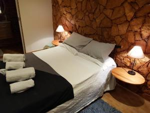 A bed or beds in a room at Ocean View Lagos - Bed & Breakfast