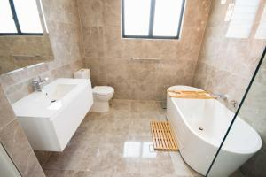 A bathroom at Beautiful Modern Luxury