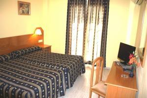 Cama o camas de una habitación en Hostal El Palomar