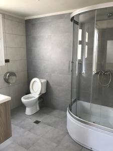 A bathroom at Lena Hotel