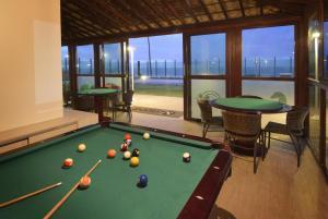 A pool table at Residência Tabatinga