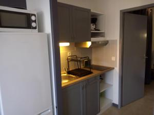 A kitchen or kitchenette at Les Residences Pinea