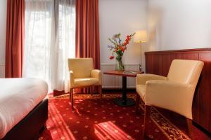 A seating area at Hotel De Schildkamp