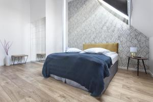 A bed or beds in a room at Dom Restauracyjny Rusiborek