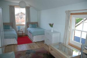 A bed or beds in a room at Mid Wales Arts B&B