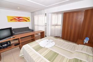A television and/or entertainment center at Mirador Praia Hotel
