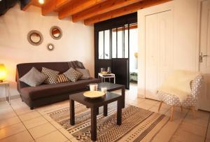 Coin salon dans l'établissement Duplex Vauban - Home-one