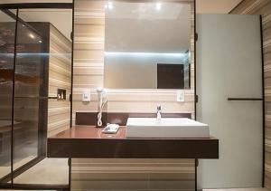 Um banheiro em Caribe Motel (Adult Only)