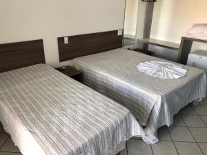 Кровать или кровати в номере Hotel Kalilândia