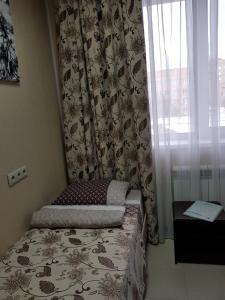 Кровать или кровати в номере Отель Агат