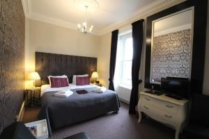 A bed or beds in a room at The Sandaig