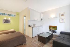 A kitchen or kitchenette at Ultimate Apartments Bondi Beach