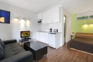 A seating area at Ultimate Apartments Bondi Beach