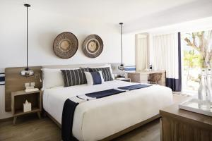 A bed or beds in a room at LUX* Grand Gaube Resort & Villas