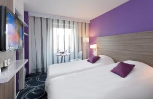 Un ou plusieurs lits dans un hébergement de l'établissement ibis Styles Grenoble Centre Gare
