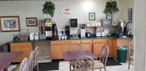 A restaurant or other place to eat at Super 8 by Wyndham Pontoon Beach IL/St. Louis MO Area