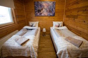 Letto o letti in una camera di Guesthouse Grund