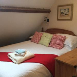 A bed or beds in a room at Ranvilles Farm House