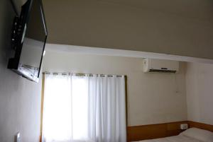 A television and/or entertainment center at Hotel Menossi