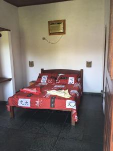 A bed or beds in a room at Pousada Conde do Mar