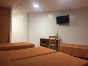 Cama o camas de una habitación en Hotel Mediterrani Blau