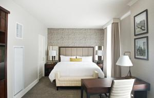 A bed or beds in a room at Marriott Syracuse Downtown