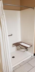 A bathroom at Super 8 by Wyndham Pontoon Beach IL/St. Louis MO Area
