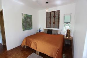 A bed or beds in a room at Hotel Villa Mozart y Macondo