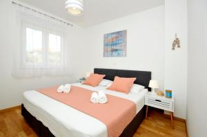 A bed or beds in a room at Apartments Town