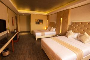 A bed or beds in a room at Appleton Boutique Hotel Cebu